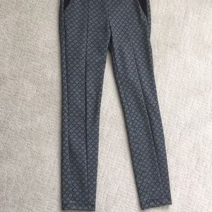 Black stretchy pants with grey diamond shapes.